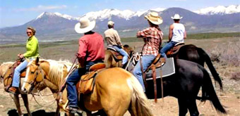 A photo of people on horseback exploring real estate near Paonia.